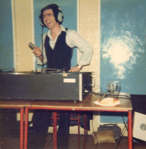 Mick Reynolds djing at a party