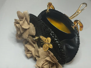 "Vintage Shiny Black Straw Purse With Tan Burlap Hand-Made Flowers Adorned With Golden Bees And Butterflies With Unusually Shaped Translucent Tortoise Lucite Handle And Golden Rope Closure. Dimensions - Height 6.25""; Length 9""; Depth 2.5""; Handle 5.5"""