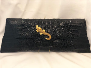 "Genuine Long Panamanian Black Crocodile Clutch - Highly Unusual Shape Adorned With Vintage Golden Crocodile Accent On The Front. Dimensions - Height 7.25""; Length 19""; Depth 3.5"""