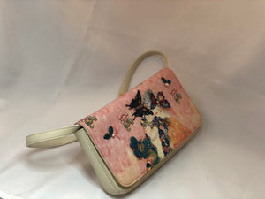 "Vintage Cream And Light Pink All Leather Clutch/ Shoulder Purse. Two Victorian Women On Front Adorned With Multi-Colored Vintage Enameled Butterflies. Dimensions - Height 5.25""; Width 9""; Depth 1.75""; Strap 10"""