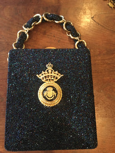 "Royal, Royal, Royal. Everything about this navy hand-beaded bag is fit for a queen. You'll be the only queen who has ever been seen with this unique jewel of an evening bag.  Dimensions - Height 6""; Width 5""; Handle 5""; Depth 2"""