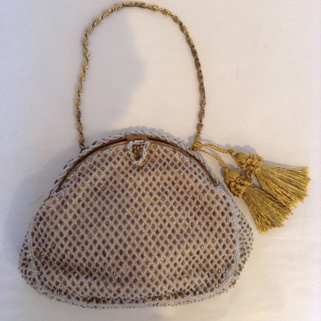 "Exquisitely hand-beaded in France, ""Bags by Josef"" created this precious bag at the turn of the century. Note the finely chased frame and beautiful silk lining.  Dimensions - Height 5 1/4""; Width 6 3/4""; Handle 4""; Depth 2"""