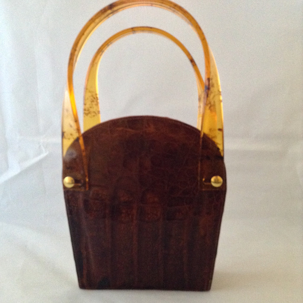 Vintage 1960s brown crocodile purse with lovely lucite handles. This unusual shape will stand out in a crowd. Hidden chain, if you love a shoulder bag.
