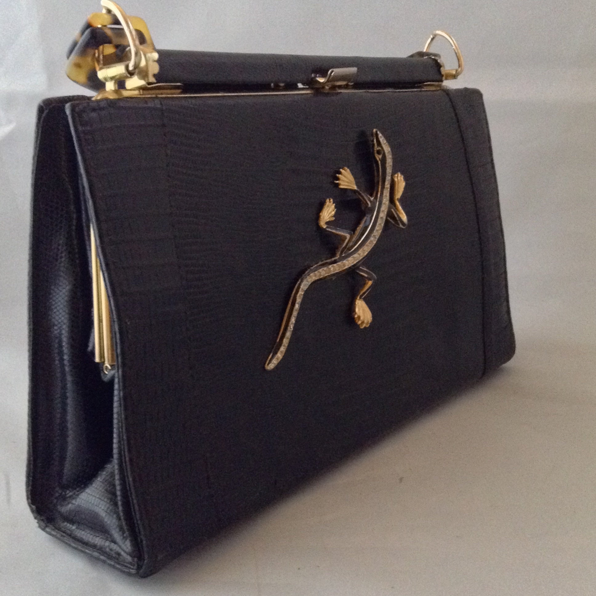 "Black On Black Lizards. Classic black lizard vintage purse with perfect proportions sports a perfect black vintage lizard and a vintage lucite tortoise handle. Perfectly perfect for every occasion.   Dimensions - 7"" Height; 10"" Width; 9-1/2"" Length with handles"