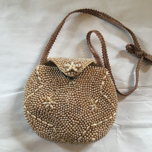 "Charming micro-beaded little neutral purse with starfish closure and french trim that will please even the smallest wearers for her special event.  Dimensions - Height 3 1/3""; Width 4""; Handle 6""; Depth 1"""