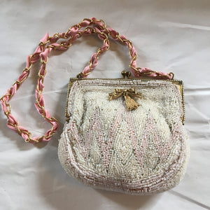 "Incredible micro-beading in shades of beige and pink, this petite purse is a thing of perfection.  Dimensions - Height 3 1/2""; Width 4 1/2""; Handle 10""; Depth 2"""
