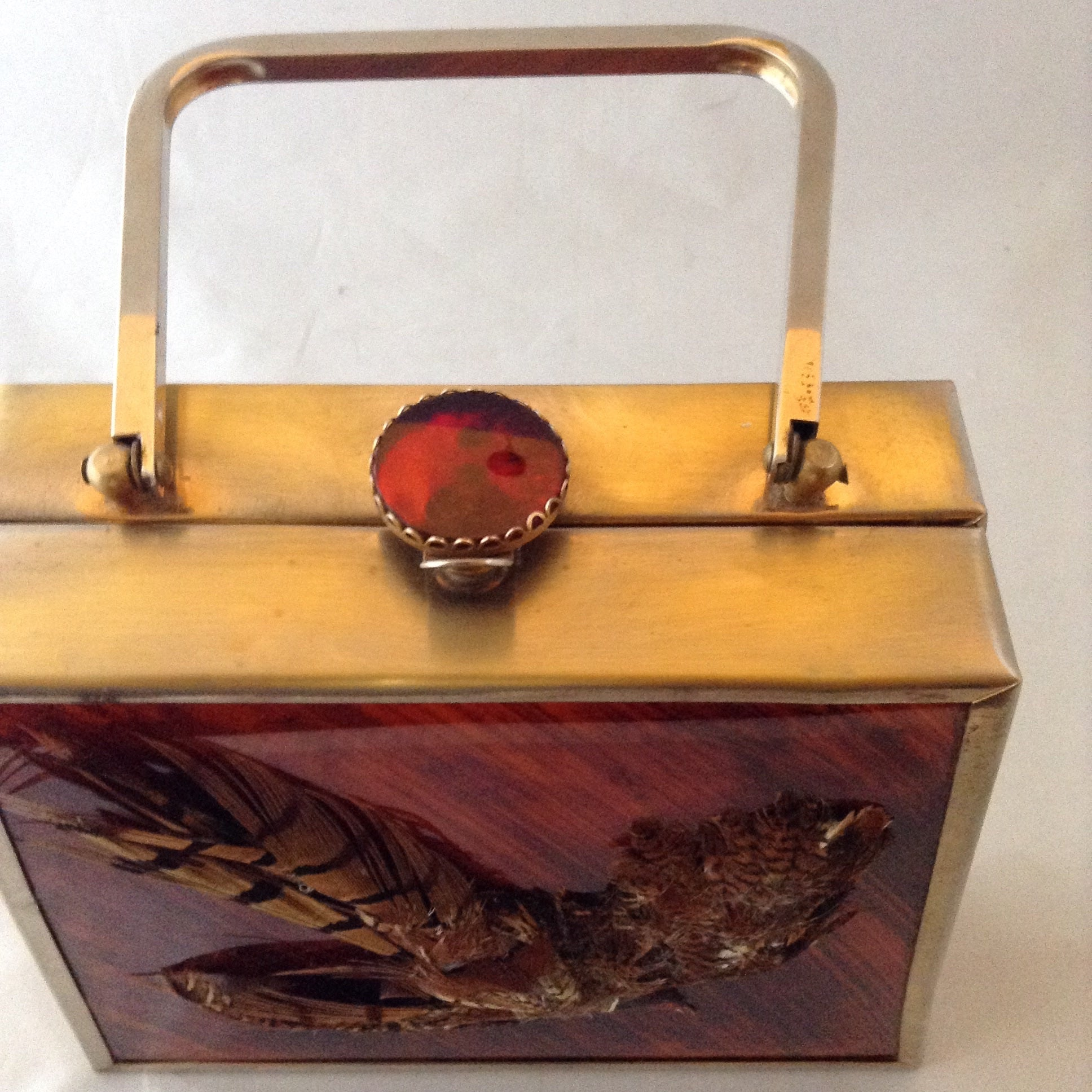 Vintage trapezoid cherry-wood colored lucite handbag with brass frame, vintage topaz colored brooch clasp and real pheasant feathers.