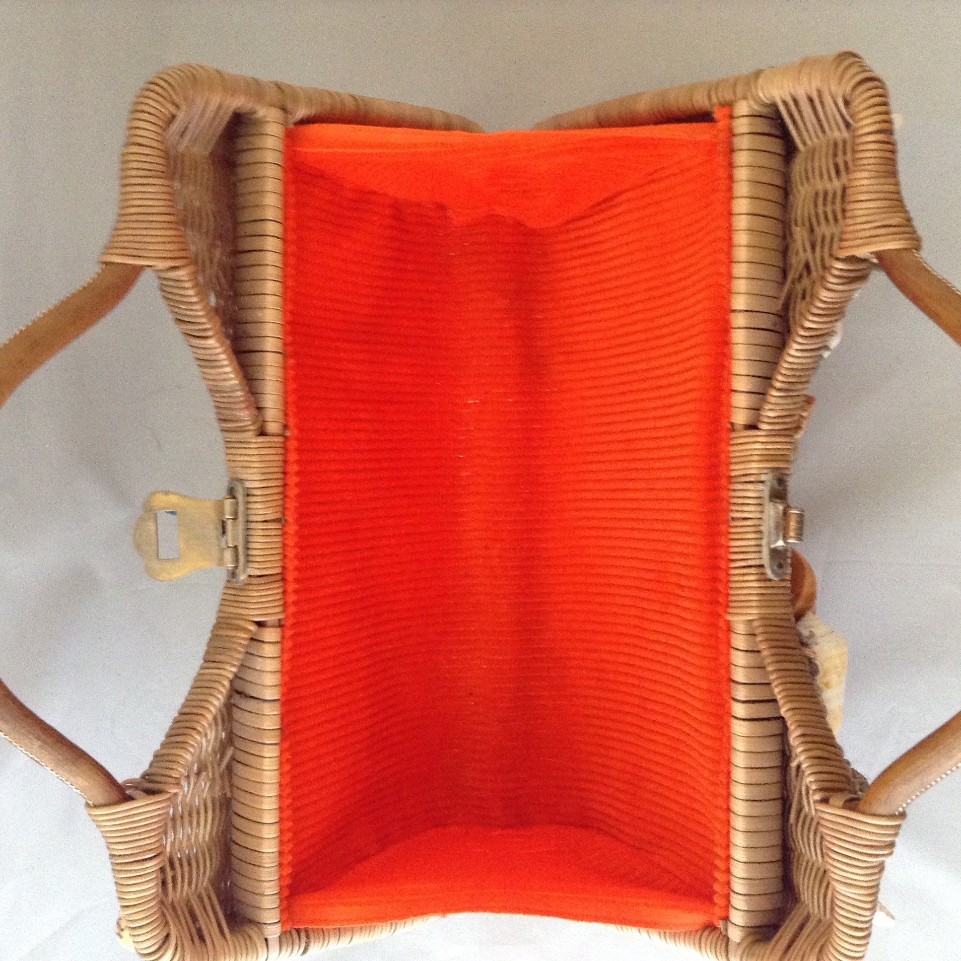 "Lovely tan straw-grass purse made in Bali in the 1960s imagines a tropical sea bed with red silk lining. 1,014 shells, large and small, went into the making of this stunning piece. (Wanna count 'em?)  Dimensions - 8-1/2"" Height; 13-1/2"" Width""; 11 Length"