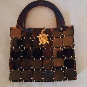 "Vintage 1960's brown lucite and chain mail handbag set off with a vintage golden turtle clasp. So unique and so much fun!   Dimensions - 7"" Height; 9"" Width; 12"" Length with handle"