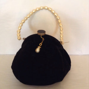 This elegant black velvet vintage purse with pearls is every gentlewoman's go-to bag.