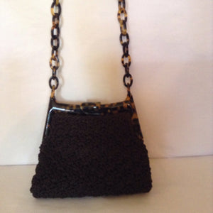 "This crocheted vintage purse masterpiece with tortoise link handle is the meeting of Bohemia and Paris.  Dimensions - Height 6""; Length 7""; Length 25""; Depth 3 1/2"""