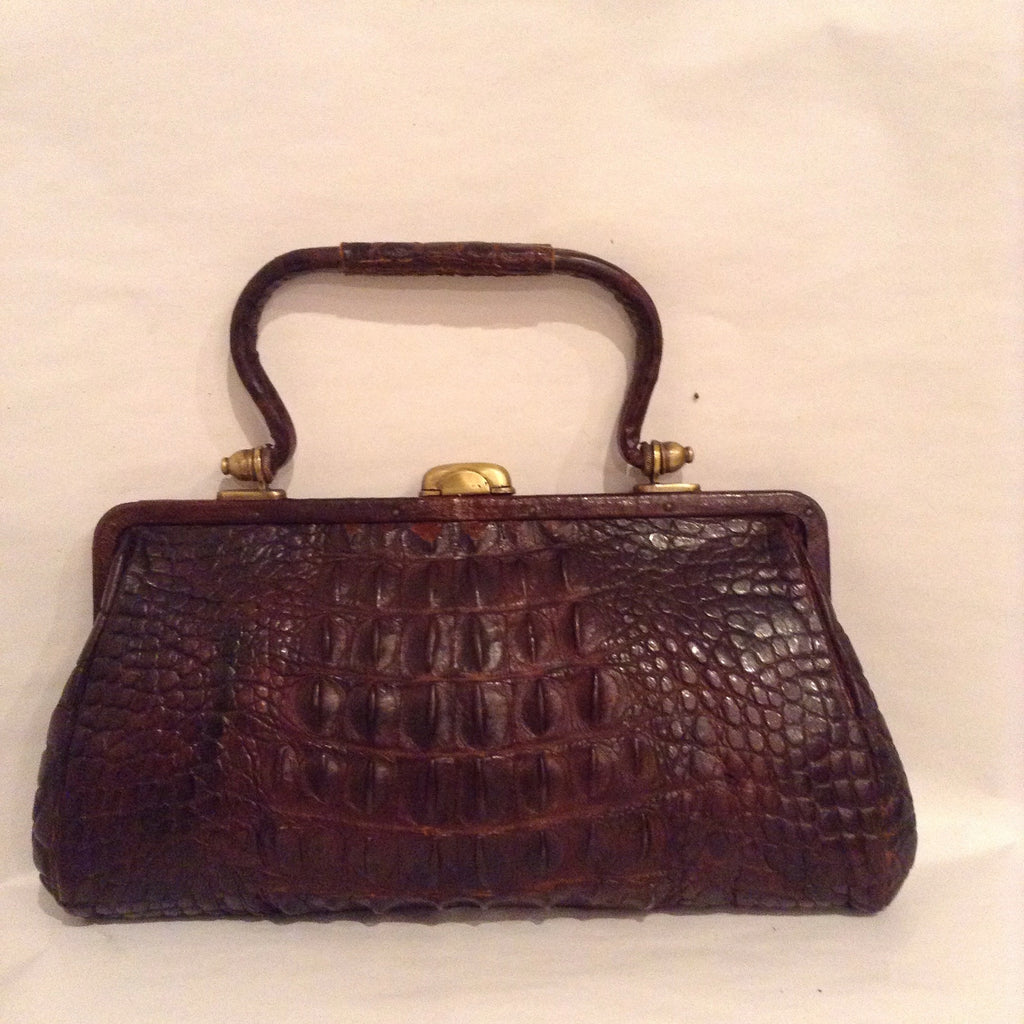 "Ultimate brown crocodile purse with brass clasp and hardware dated from 1904. A timeless classic! Dimensions - Height 5""; Width 9""; Depth 2""; Handle 4"""