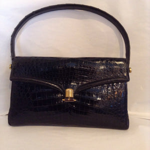 Vintage black crocodile purse made in Buenos Aires in the 60's by master craftsmen whose family business no longer exists. One of a kind, beautifully made, like new.