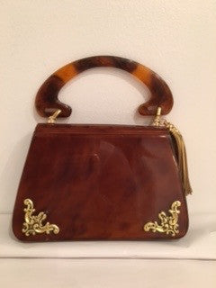 "Demure, yet attention-attracting , this 1940s era tortoise Lucite bag is the perfect size for lunch, evening or the polo matches.  Dimensions - Height 4 1/2""; Length 7""; Handle 4""; Depth 2 1/4"""