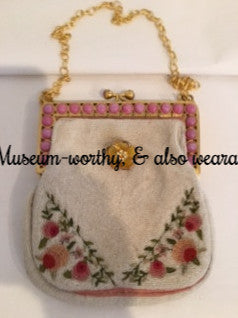 "Micro-beading, hand-embroidered petit-point roses and lovely original hardware make this little Parisian 1940s bag a museum-quality treasure. The rose pink chalcedony stones are all original and in perfect condition, as is the exquisite hand-chased frame.  The original handle has been replaced with a beautiful vintage chain which detaches to wear as a necklace if you wish. Dimensions - 6"" Height; 5"" Width; 2"" Depth. Chain 9"" (Chain becomes an 18"" necklace when detached.)"