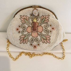 "Perfect for the mother of the bride or a romantic bridesmaid, this vintage beaded purse is perfect & will fit all your wedding day needs.  Perfect, too for an evening at the opera or a dressy luncheon event.  By famous maker Walborg in Paris circa 1940  Dimensions - Height 7""; Width 5 1/2""; Depth 3"""