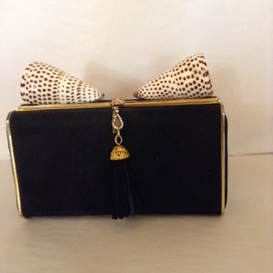 "Sophisticated, yet whimsical. this black suede clutch with beaded tassel goes from day to night with its shell toppers.  Substantial, classy, easy to carry.  You're a diva in your little black dress with style that speaks softly but carries a big WOW!  Dimensions - Height 4 1/2""; Length 7 3/4""; Height 26""; Depth 2"""