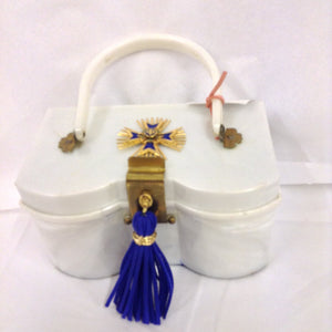 "Unusual shape, color, hardware and vintage Maltese cross make this white lucite purse a necessity for your summer vacation to the Islands. White whites and blue blues with shiny brass accents complete the nautical theme of this fantastic classic.  Dimensions - Height 4""; Width 7 1/4""; Length 8 1/4""; Depth 4"""