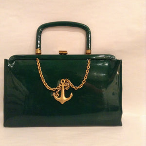 "Fun little forest green patent leather with vintage fouled anchor and chain motif. The handle folds into the bag for use as a clutch.  Dimensions - Height 5 1/4""; Width 8 1/2""; Handle 2 1/2""; Depth 1 1/4"""