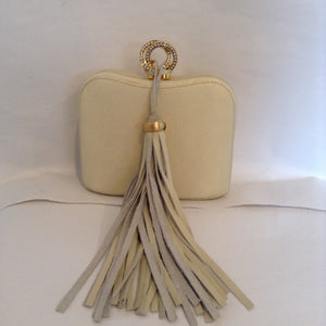 "Delightful winter white leather vintage purse from the glamorous Rodo bag-maker of Italy.  The crystal-encrusted clasp and oversized suede tassel lend extra presence, and the tuck-in chain allows you to carry it as a clutch or shoulder bag.  Day or night, summer or winter, you will feel like a queen with this gorgeous bag.  Dimensions - Height 4 1/2""; Width 5 3/4""; Handle 23""; Depth 2 1/4"""