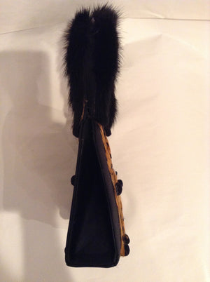 "Vintage Julie Feldman purse.  Real mink handles, bird feathers and tiny pom-poms are charming additions to this classic black satin bag.  Its unique shape and style works as well for day as for evening.  Dimensions - Height 6-1/2""; Width 5-1/2""; Depth 2""; Handle: 5-1/2"""