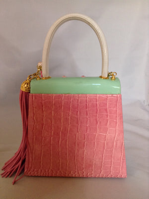 "Faux croc in pink and sea-foam patent leather adorned with crystal beads and a pink suede tassel, this 60's bag has a new life with its striped silk lining and detachable cross-body cord.  Dimensions - 7"" Height; 7.5"" Width; 3"" Depth; Handle 4""; Cord 22"""