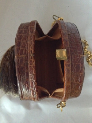 "Beautiful brown South American vintage crocodile purse, a vintage Austrian hunting token, and a simple classic shape. The heavy chain detaches to be worn as a necklace or bracelet which looks and feels like 18K gold!  Dimensions - Height 5.5""; Length 7.5""; Width 3.5""; Chain 28"""