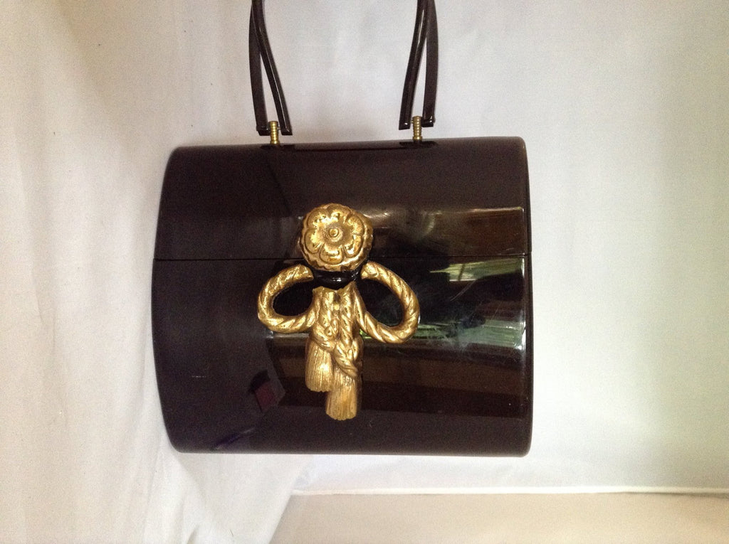 "Classic black Wilardy lucite vintage purse from 1950s Miami adorned with a gold-leafed vintage bowknot.   You will have this in your wardrobe forever. So very Elizabeth Taylor!  Dimensions - Height 7.5""; Width 8.5""; Depth 5""; Handle 6"""