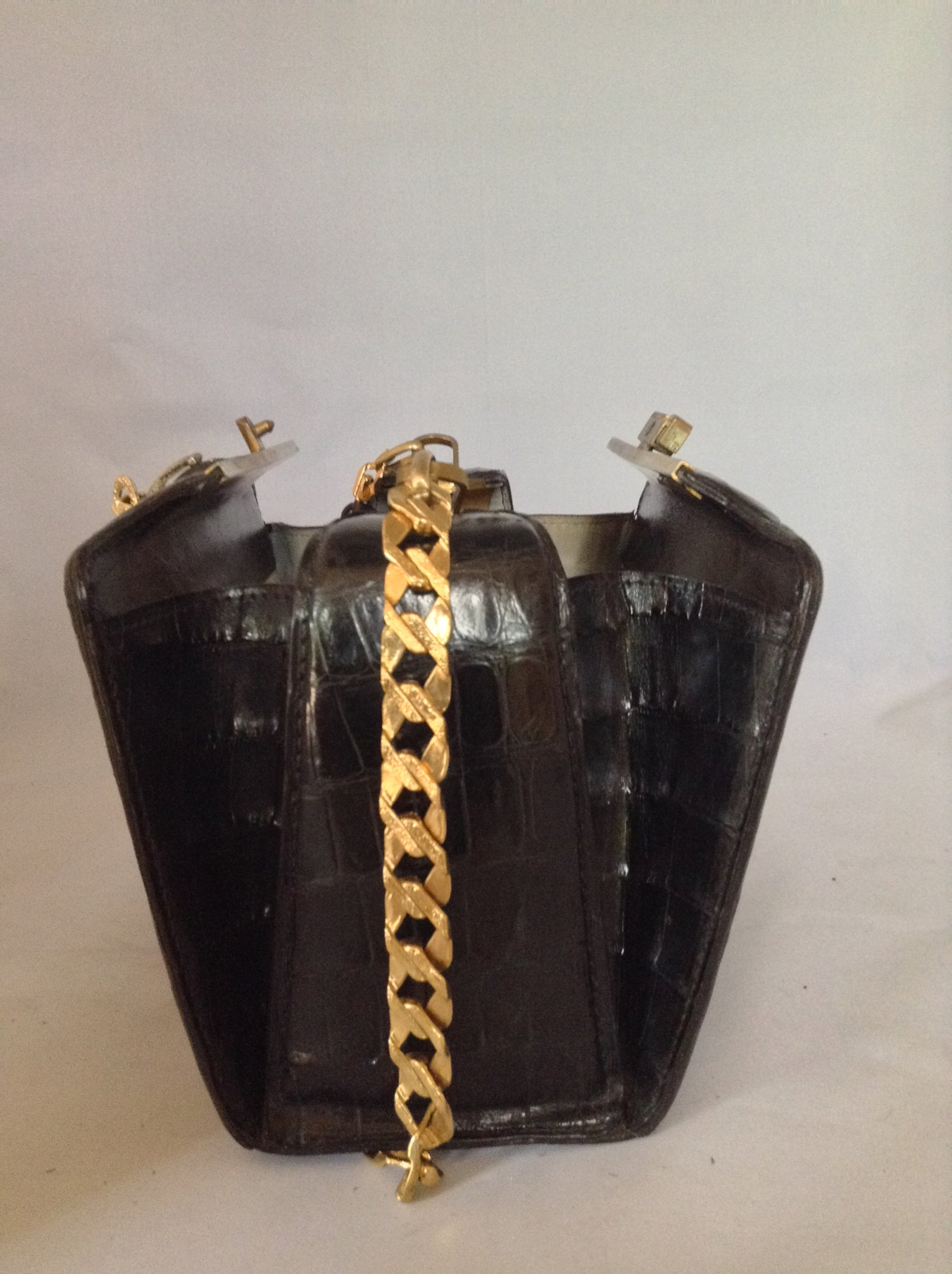 "From one of the finest makers in Argentina, we found this beautiful black crocodile vintage purse in a couture shop in Buenos Aires (they did have other things of hers). But for sure you'll feel like Evita when you carry it!  Dimensions - Height 6""; Width 9""; Depth 5""; Chain 12"""