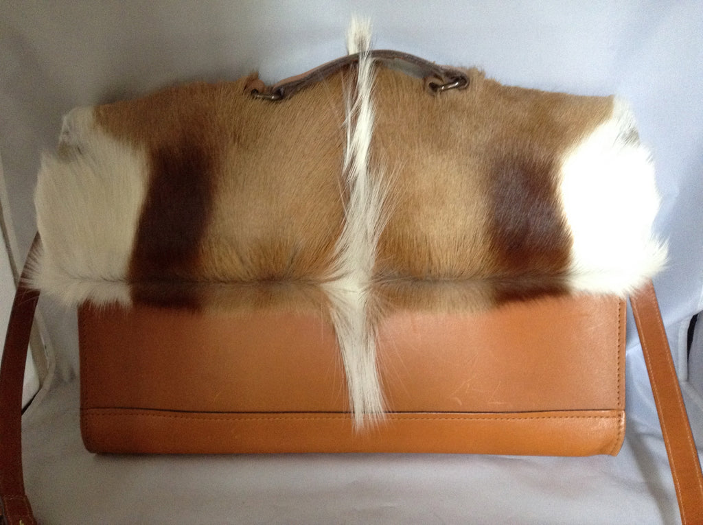 "Wherever you go, this gorgeous vintage soft leather springbok briefcase will show that you're confident, stylish, practical and good at thinking outside of the box. One of a kind.  Dimensions - 16"" Length; 12"" Height; 12"" Width"