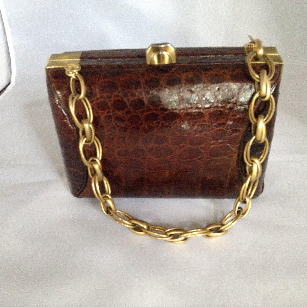 "Vintage light brown crocodile lunchbox purse with original gleaming brass hardware and unusual heavy chain. Roomy, classical and timeless.  Dimensions - 7"" Height; 5"" Length; 3-1/2"" Depth"