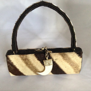 Long vintage purse with African zebra, snake and tiger skins... which ones are real and which are faux?   Only you will know for sure about the skins on this distinctive barrel-shaped handbag. (Ask us for the answer!). Includes a dangling tooth pendant with ornate antique silver top.