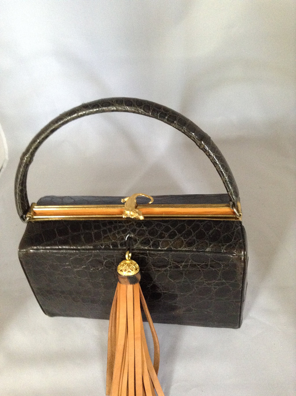 "This magnificent vintage black alligator purse was made in Belgium in the 1950's for Saks and Bonwit Teller. The production was limited, so they are sought after by collectors. This example could retail for over $1000.00 (if you can find one.)  Dimensions - Height 9""; Length 7""; Depth 4"""