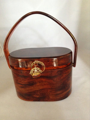 "This vintage purse is the perfect marriage of a vintage tortoise carving poised au tremblant atop an oval 1950s lucite example by Wilardy. Antique amber and gold fob adorn the front. So classic, yet so today.  Dimensions - Height 6""; Length 4""; Depth 5"""