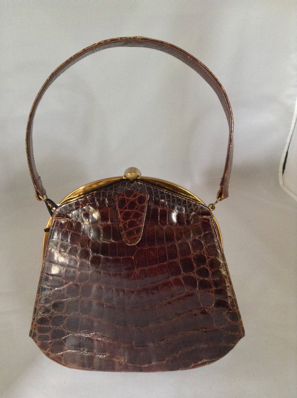 "Vintage brown alligator purse by Deitsch who was an American maker of luxury reptile bags from the 1940's. It is so rare to find a pristine example that we added only a set of vintage tassels from the period (and we'll happily remove them for you purists out there!).  Dimensions - Height 8""; Length 8""; Width 2"""