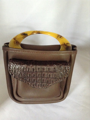 "Extraordinary vintage brown crocodile, leather and tortoise lucite handle pouch bag. Originally designed as a lady huntress's shell bag, we thought this was way too pretty to waste on wild game. (But you're welcome to do so!)  Dimensions - Height 9""; Length 7""; Width 2"""
