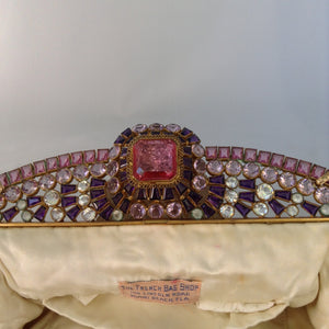 "Vintage original cream beaded purse with a crown-like-handle adorned with pink, purple & white jewels, silk lining and a golden cross-body removable chain so you can gracefully toss those beads from your MardiGras float! Ooh-la-la! Magnificent, My Dear!  Dimensions - Height 6.5""; Length 9.5""; Depth 2"""