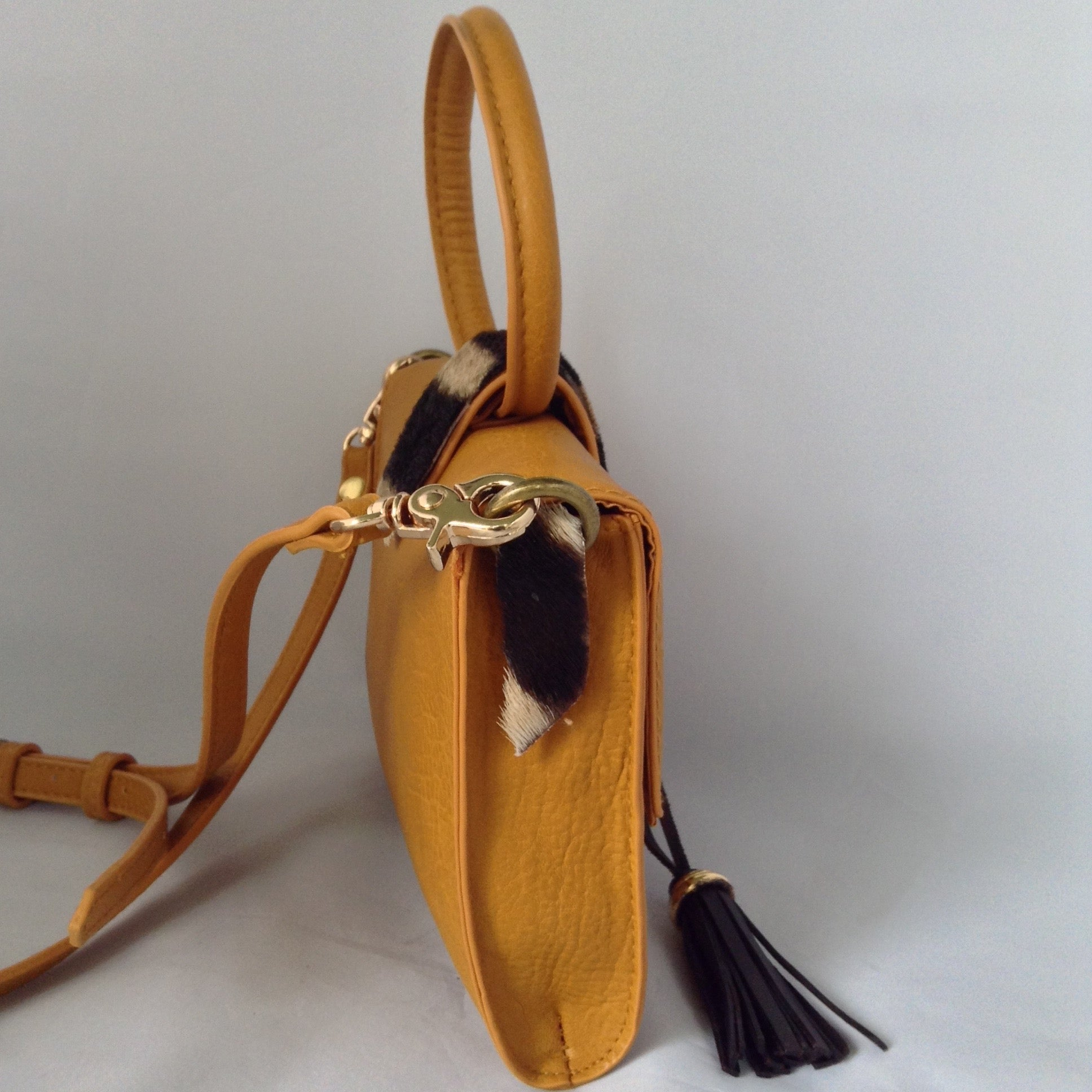 "Charming ""O"" handle in vibrant mustard with accents of real zebra hide make for a darling vintage clutch. Add the detachable leather strap and voila - a cross-body charmer.  Dimensions - Height 6""; Width 8""; Depth 2"""