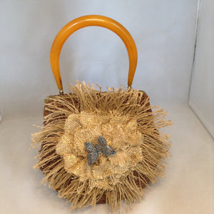 "Vintage Brown Raffia Purse Signed MM With Original Amber Lucite Handle And Vintage Marquasite Blue Butterfly On Handmade Tan Burlap Rose. Dimensions - Height 7""; Length 9.5""; Depth 5.5""; Handle 5"""