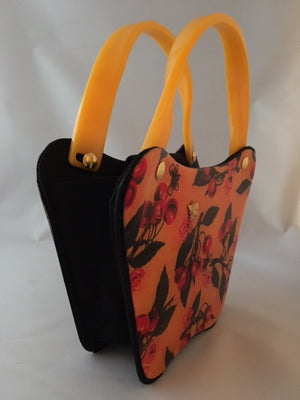 "Bees love cherry blossoms, right? This little vintage yellow, black and red bag with its unusual curves is such a charmer.  Dimensions - Height 6""; Width 8""; Depth 3""; Handle 4"""