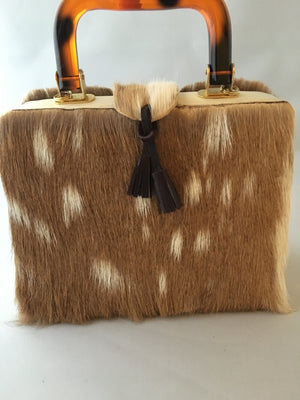 "Would that be an Axis??? Square vintage handbag covered in baby deer pelt with an ostrich placket and tortoise buttons. What a combo!  Dimensions - Height 9""; Width 9""; Depth 3""; Handle 4"""