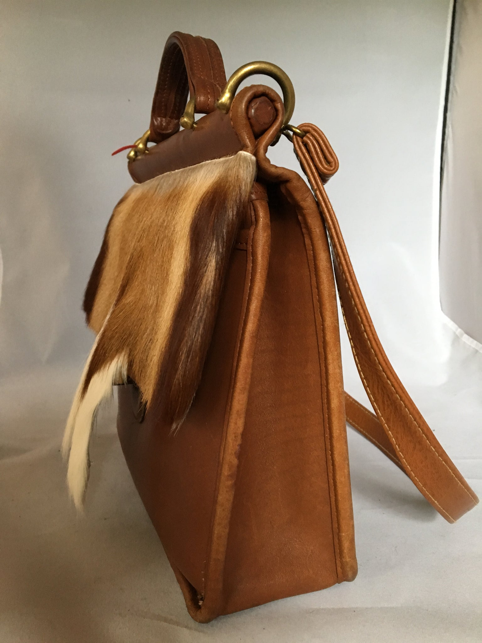 "This original 1960's Coach bag has been updated with a silky soft antelope pelt. Your next business meeting will start with oohs and ahs as you take out your notebook and files.  Dimensions - Height 10""; Length 10""; Depth 3"""