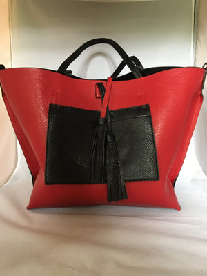 "This English tote-style handbag is perfect for the world traveler since it reverses from practical black to fiery red and it even comes wit a matching clutch. How ""veddy, veddy"" British!   Dimensions - Height 13""; Length 12""; Depth 7"""
