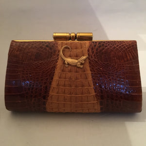 "Vintage purse with two tones of caramel in baby crocodile leather, sturdy brass hardware and leather lining. Golden crocodile pendant on front. This baby will only get better as it grows older!  Dimensions - Height 5""; Width 7-1/2""; Depth 2-1/2"""