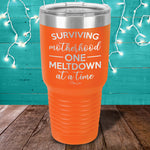 Surviving Motherhood One Meltdown At A Time Laser Etched Tumbler