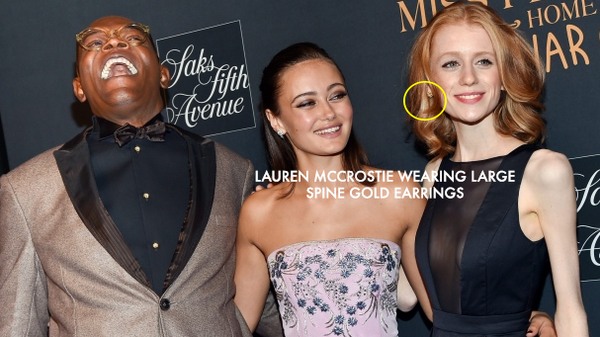 Hollywood actress Lauren McCrostie wears Spine earrings in Gold at Tim Burton Film Premier