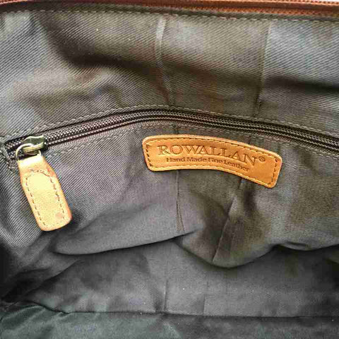 Inside a Rowallan Tan Leather Curved Handbag
