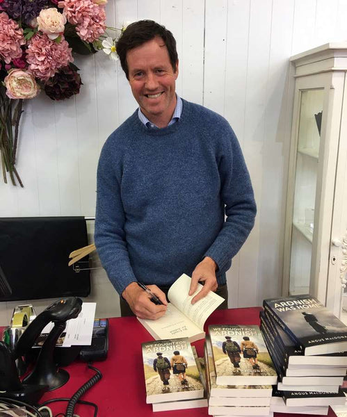 Angus MacDonald author of We Fought For Ardnish signing copies at The Old School Beauly