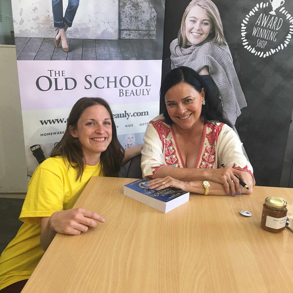 Diana Gabaldon signing a book for The Highland Hospice at The Old School Beauly