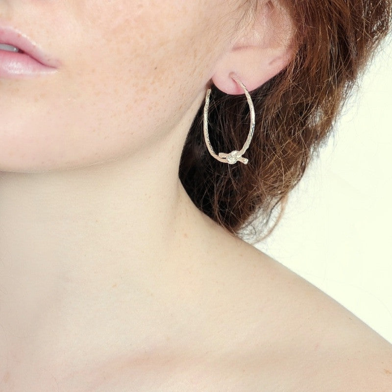 Knotted String Sterling Silver Hoop Earrings on model